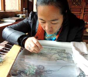 Xiongyang, Pumi nationality,Yunnan Supeior Ethnic Embroidery master and one of the most embroidery masters of Baisha Naxi Embroidey Institute
